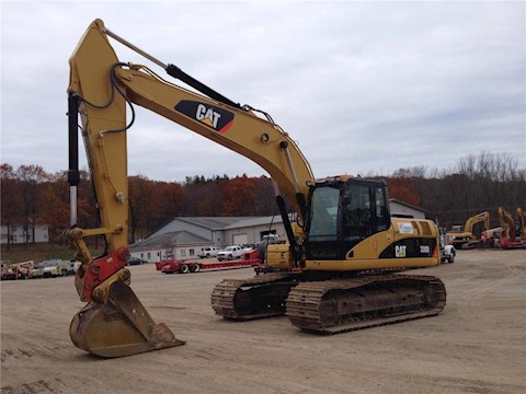 2010 Caterpillar 320DL - Caterpillar Excavators